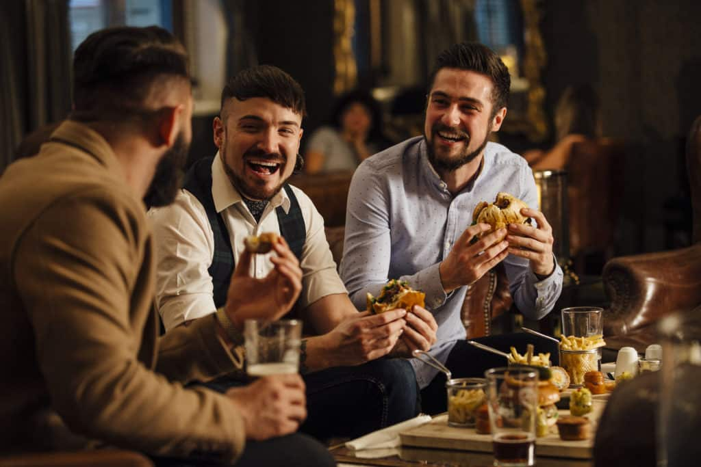 Men's group, men talking and laughing